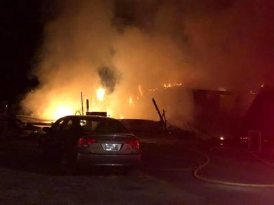 Fire destroys house, family gets out safely