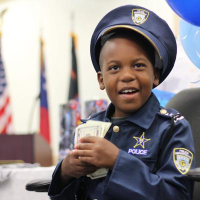 Superhero Crimefighter Ofc. Juvell Harris, 8, dies of brain cancer
