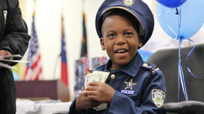 Superhero Crimefighter Ofc. Juvell Harris, 8, dies of brain cancer