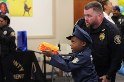 """PROCLAMATION: CCPD Honorary Officer Juvell Harris is """"our superhero and our brother"""""""