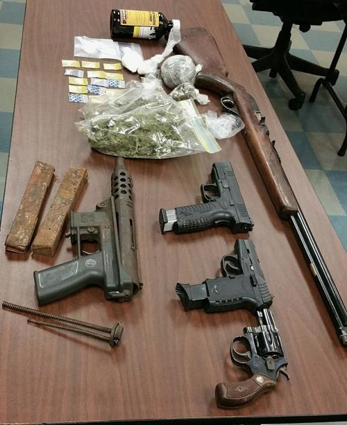 Drugs, firearms discovered while serving temporary protective order