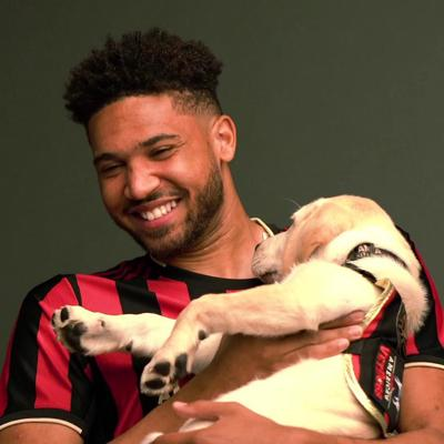 Atlanta United service dog Spike interacts with players