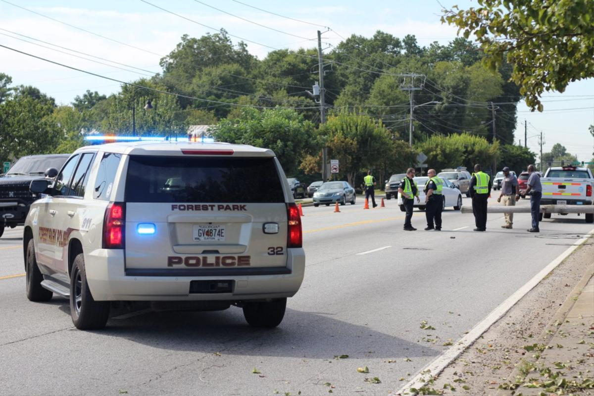 Snagged power lines stop traffic on Old Dixie Road in Forest Park