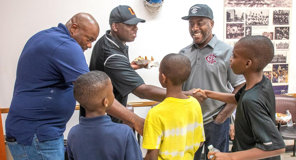 Historic huddle at barbershop offers 'a positive outlook on things'