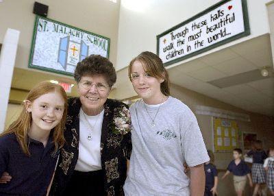 Sister Sara with 2 students.jpg