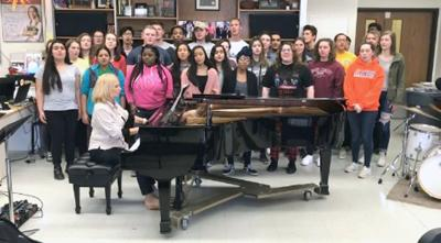 Centennial choir members to join Foreigner on stage
