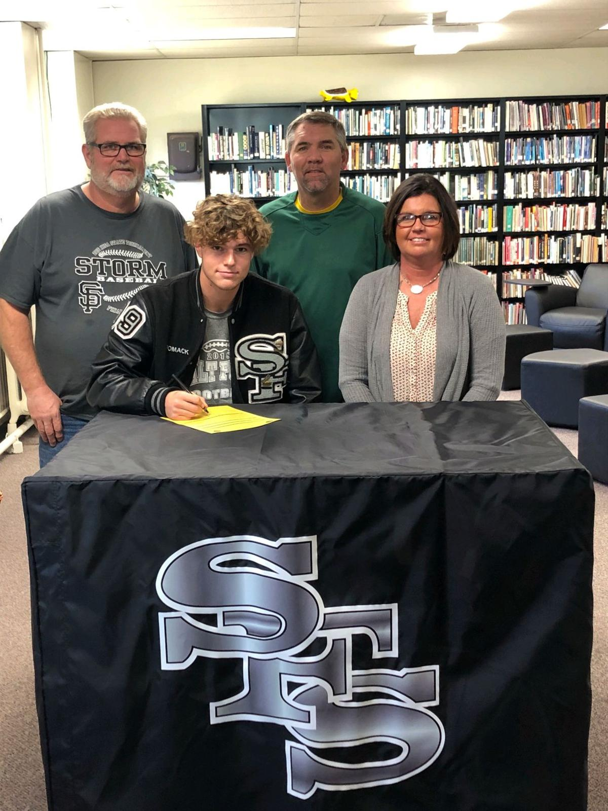 Gage Romack signs