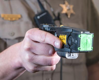 Champaign police seek OK for Tasers