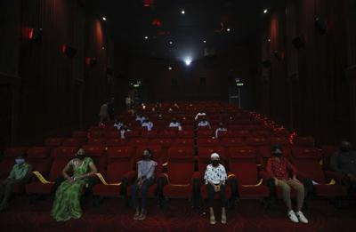 APTOPIX Virus Outbreak India Cinemas Reopen