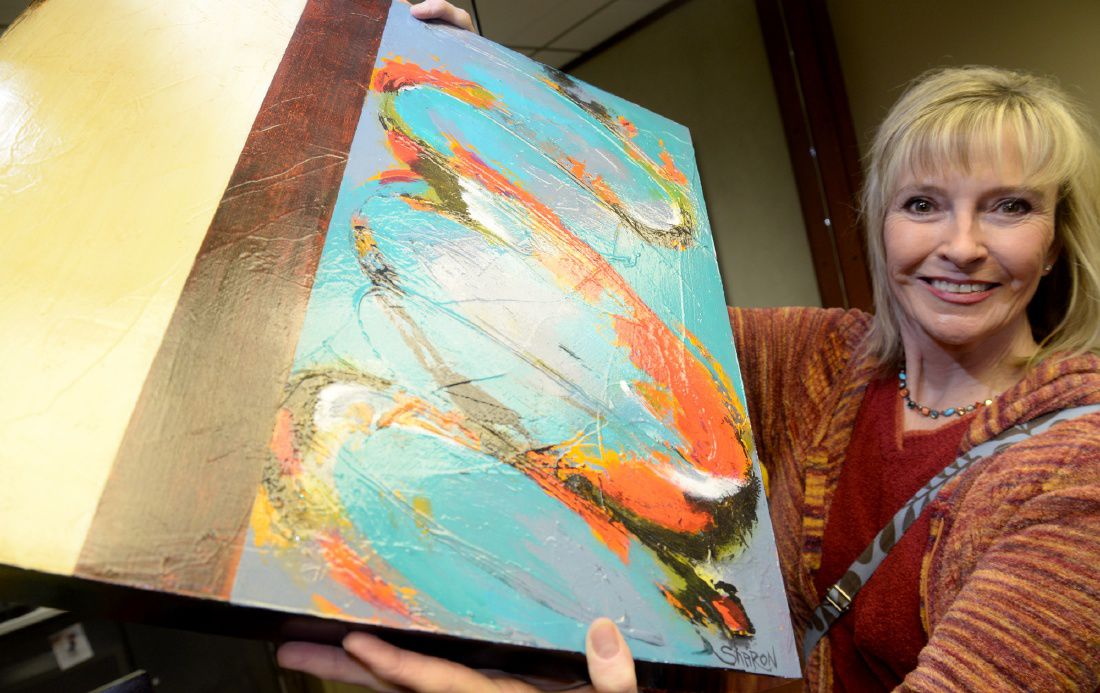 Local artist creates vibrant focal point in former bank teller's window