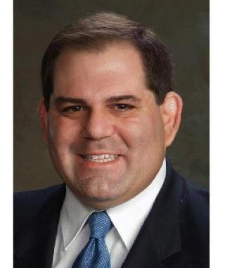 Andrew G.  Khoury
