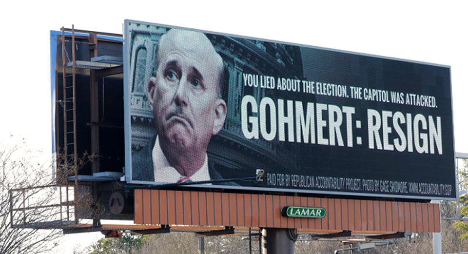Billboard sign asking Congressman Louie Gohmert to resign