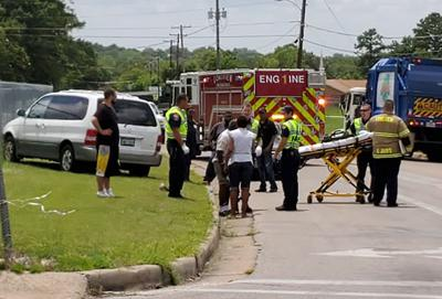 Vehicle rolls onto man in Longview while he pushes it