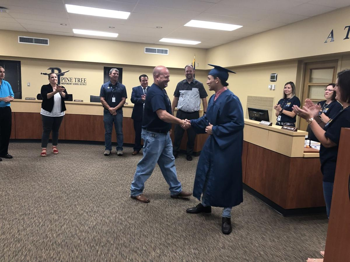 Pine Tree ISD school board graduates senior, sets tax rate