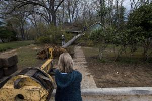 Storm-affected residents near Link Road pick up pieces after tornado