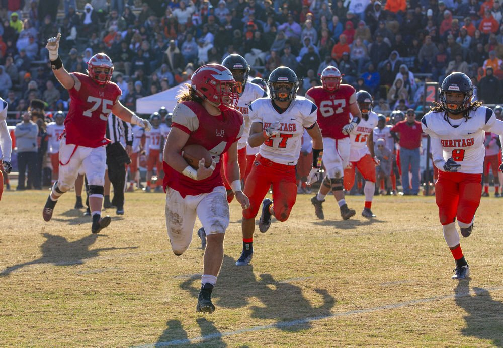 Lord Botetourt's (4) Hunter Rice breaks free on a long run as Heritage's ( 27) Kristian Rivera and (8) Jaleel Carthorne pursue. (75) Colston Powers and (67) Gage Bassham follow the play.