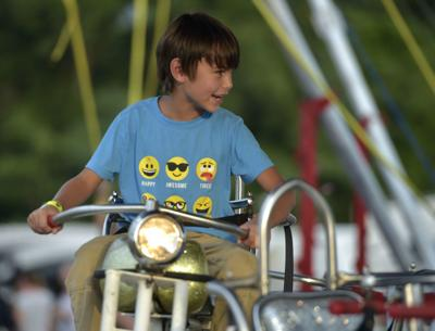 Taylor Kane, 7, of Amherst rides a motorcycle ride at the Amherst County Fair