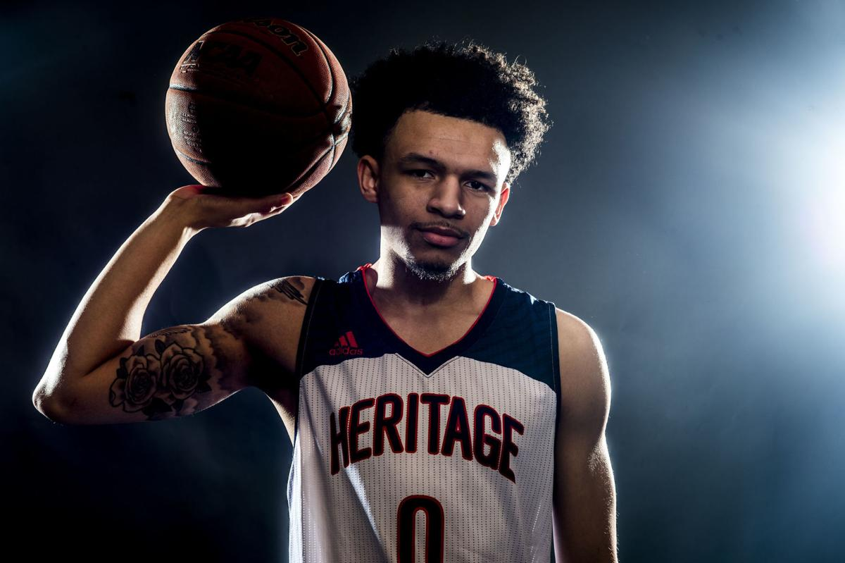 all area boys basketball player of the year cj rosser heritage