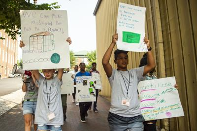 Local children and community members march against youth incarceration