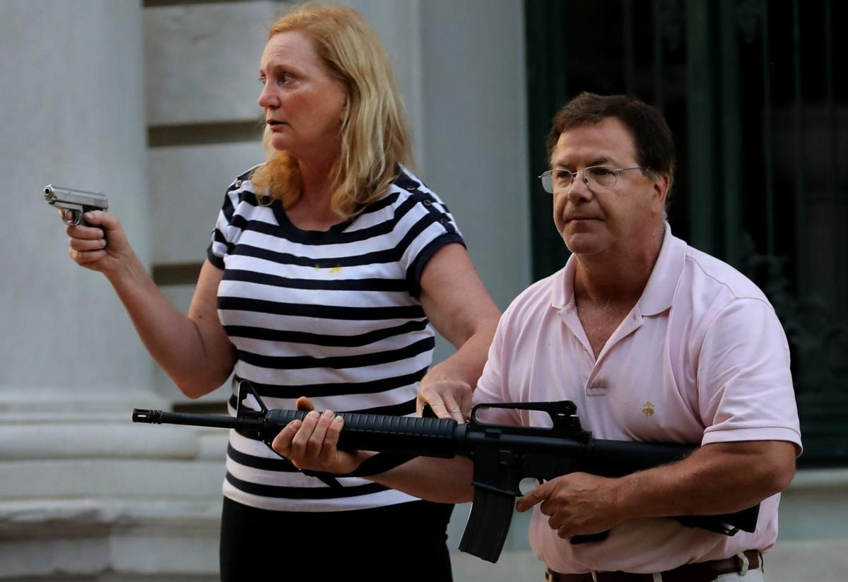Central West End couple display guns during protest
