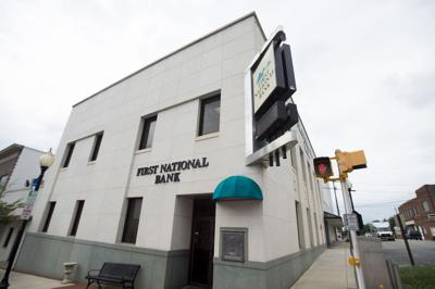 First National Bank's parent company posts record quarterly