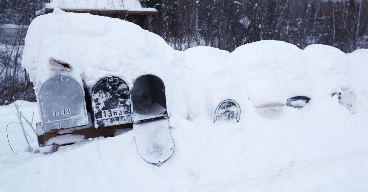 Hundreds without power as winter storm drops more snow on