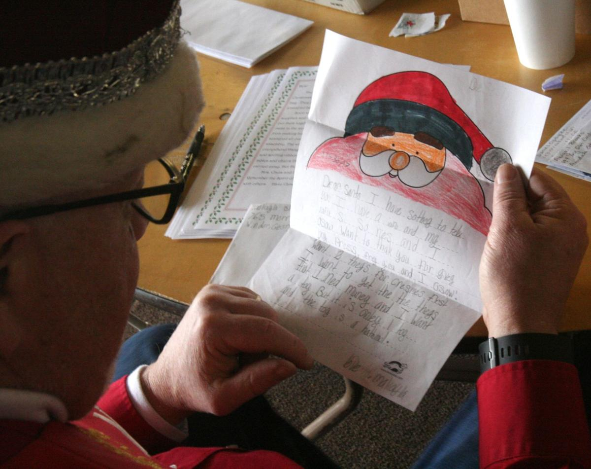 Volunteer Elves Dig Into Backlog Of Plus Letters To Santa