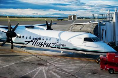 Alaska Airlines Q400 with jet bridge