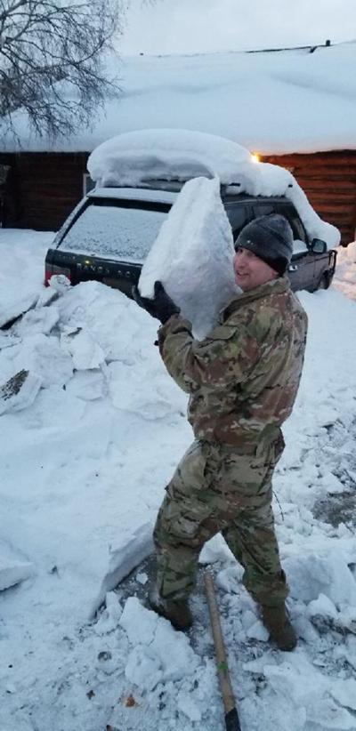 Soldiers surprise seniors with shoveled driveways