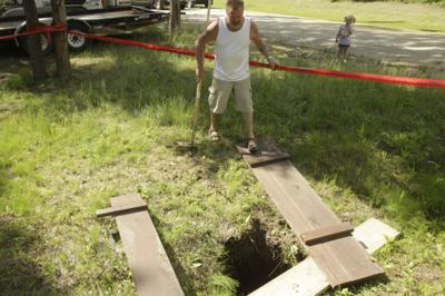 Deep sinkhole appears in man's yard