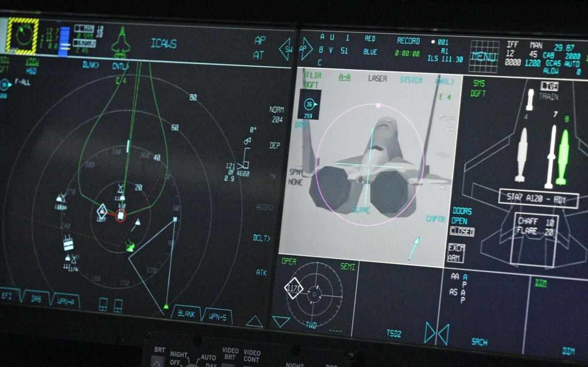 Fairbanksans try a F-35 in a simulator from Lockheed Martin