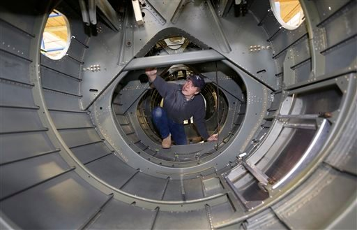 Volunteer Ron Culbertson Works Inside The Tail Section Of A B 17 World War  II Era Bomber Being Built From Salvaged And Fabricated Parts At The  Champaign ...