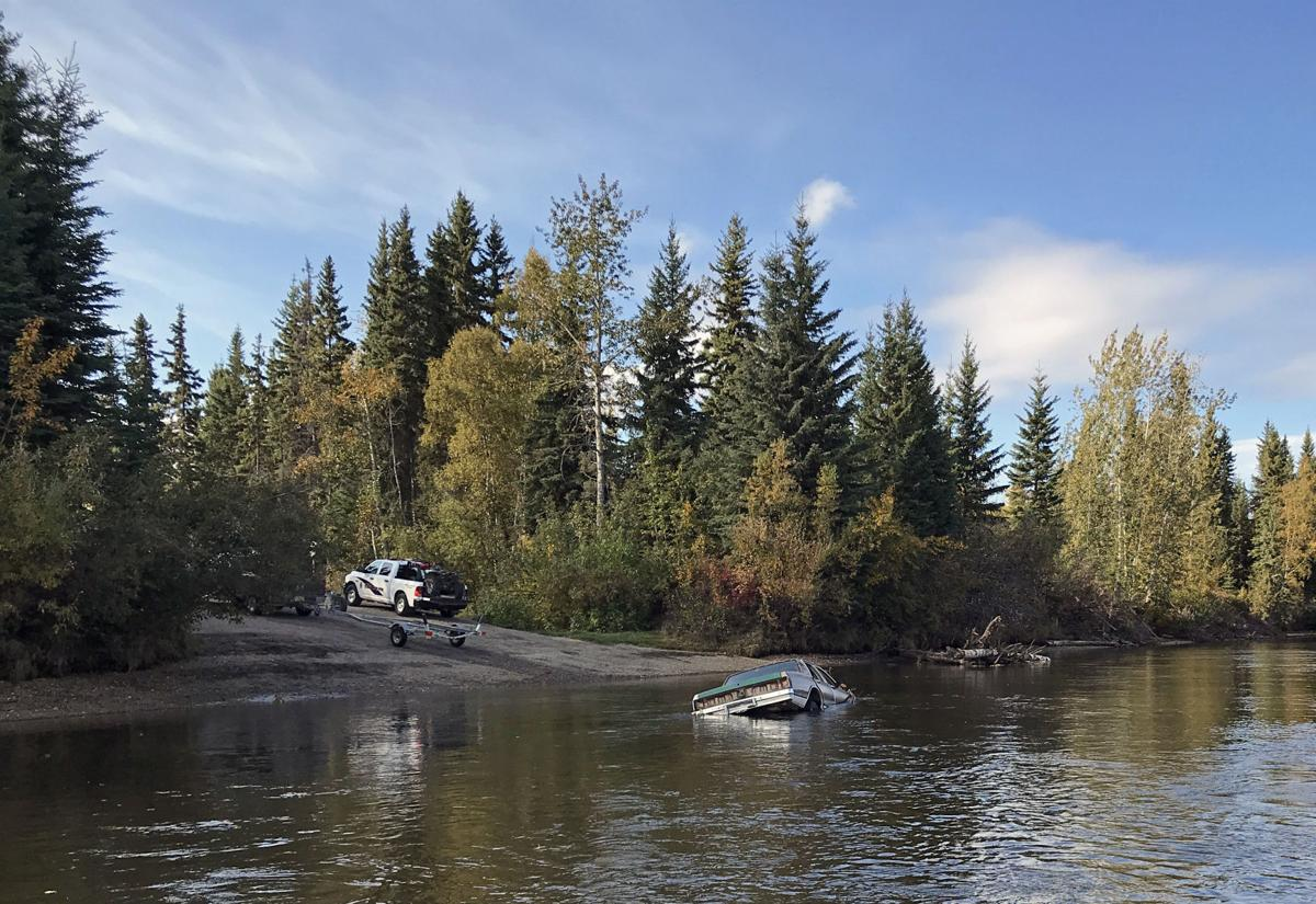 Car in Chena River