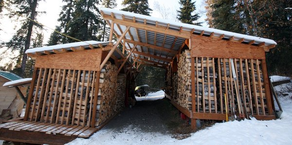 Fairbanks couple s drive thru woodshed design stacks up for Well shed plans