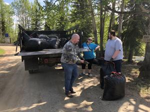 Volunteers aid in cemetery cleanup