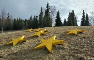 Volunteers repaint Birch Hill Cemetery stars