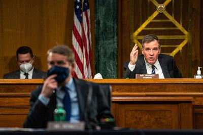 Mark Warner gives an opening statement during the Senate Intelligence Committee hearing on Capitol Hill in Washington, DC, USA, February 23, 2021.