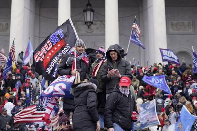 Protesters storm the Capitol and halt a joint session of the 117th Congress on Wednesday, Jan. 6, 2021, in Washington, D.C..