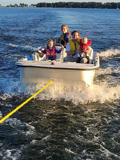 Children enjoy the tow to safety on October 3.