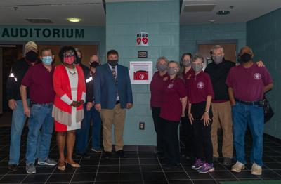 Left to right: Greg Hanson, Jaime Packett, NMS Assistant Principal Dawn Conley-Taylor, Robert Hundley, Captain Jeff Plumb, NMS Principal Patrick Simmons, President Valerie Barton, Jeanne Widenmer, Debbie Evans, Rebekah Haynie, Julian Watson, Garfield Parker   Left to right: Greg Hanson, Jaime Packett, NMS Assistant Principal Dawn Conley-Taylor, Robert Hundley, Captain Jeff Plumb, NMS Principal Patrick Simmons, President Valerie Barton, Jeanne Widenmer, Debbie Evans, Rebekah Haynie, Julian Watson, Garfield Parker