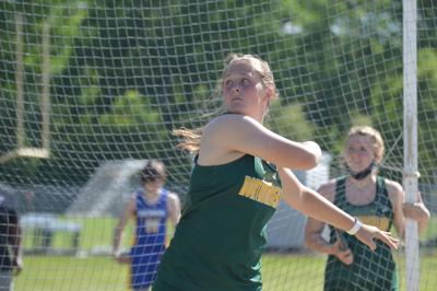 Cassidy Lane hurls the discus for a personal best.