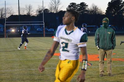 Denzell Palmer warms up before the game.
