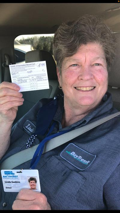 Linda Gaskins with COVID vaccination card1 (002)