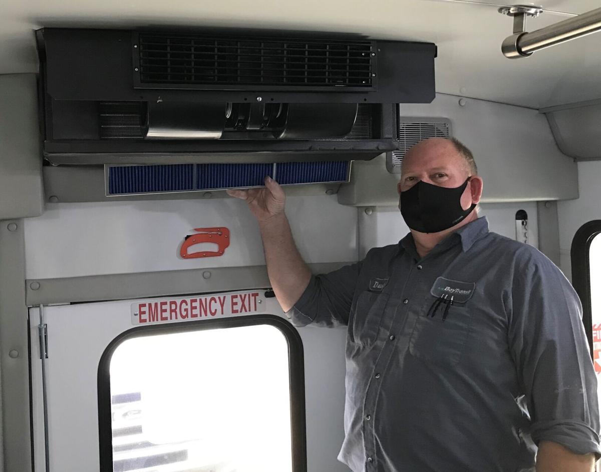 David Fols, Bay Transit's Fleet Manager, installing a Freudenberg Filtration premium cabin filter in a Bay Transit bus.