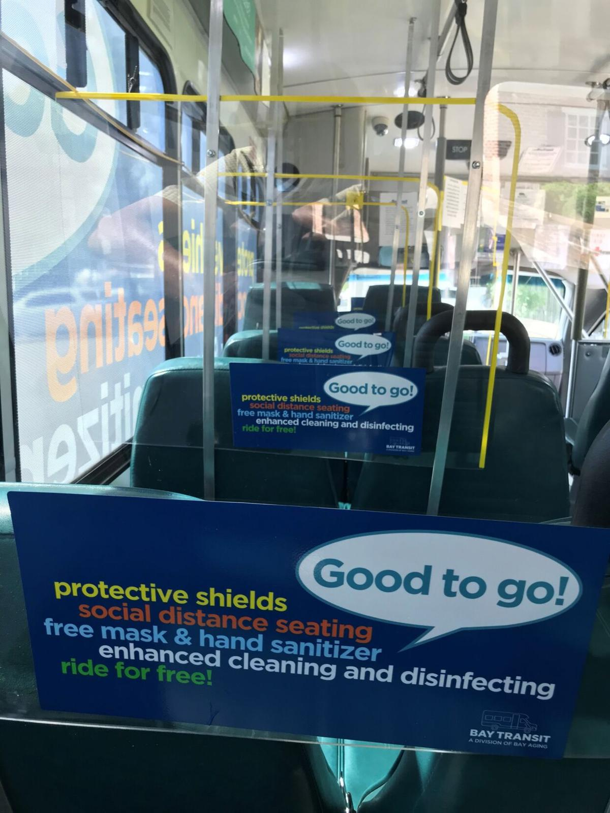 'Good to go!' stickers affixed to the plexiglass partitions between every seat on every bus.