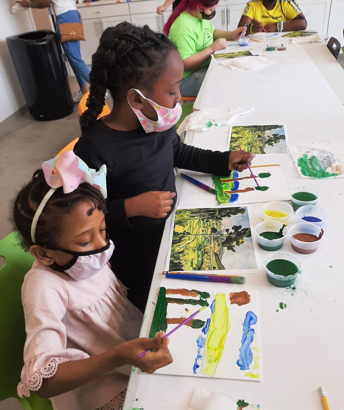 """Eva Gueye (front) and Kelis Sutton copy Paul Cézanne's """"Mont Sainte- Victoire."""""""