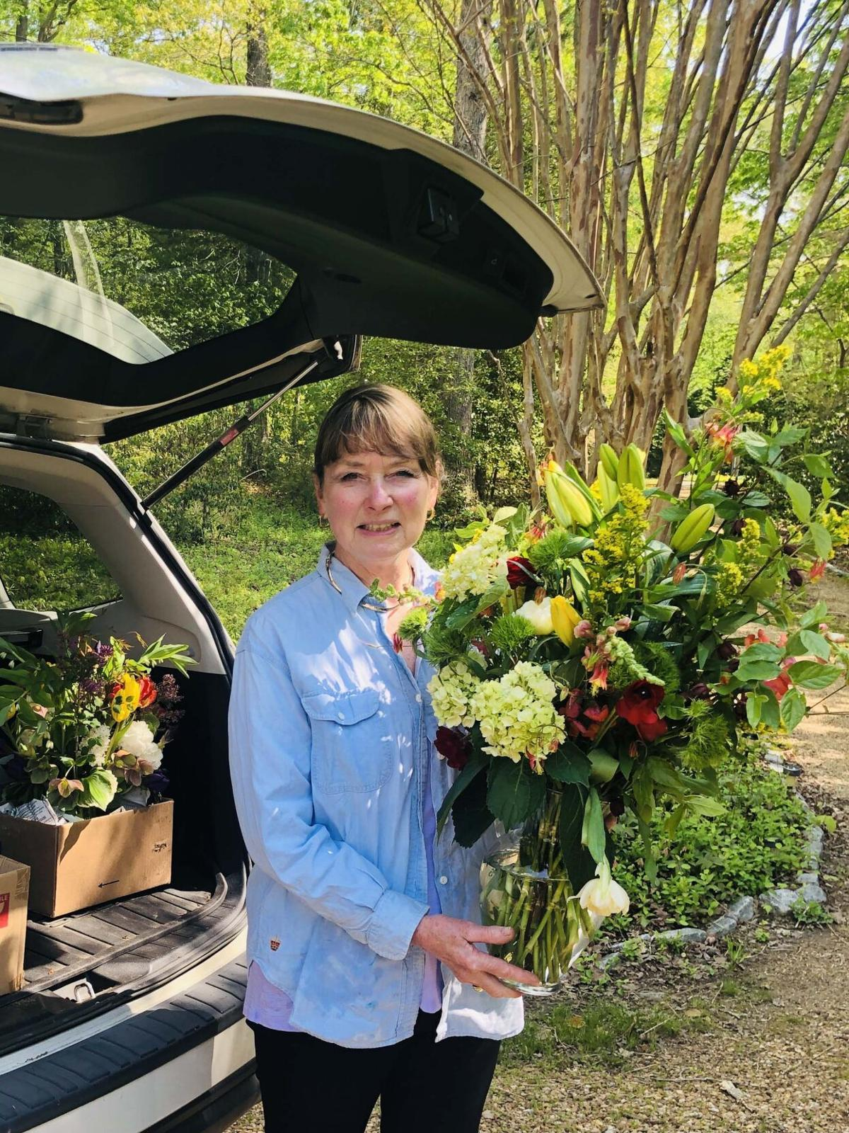GCNN vice president Ann Thorton delivers floral arrangements to HGW home owners.