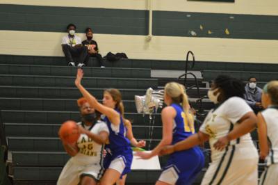 Tanaya Seldon, the district's leading scorer, brings the ball up court against Mathews.