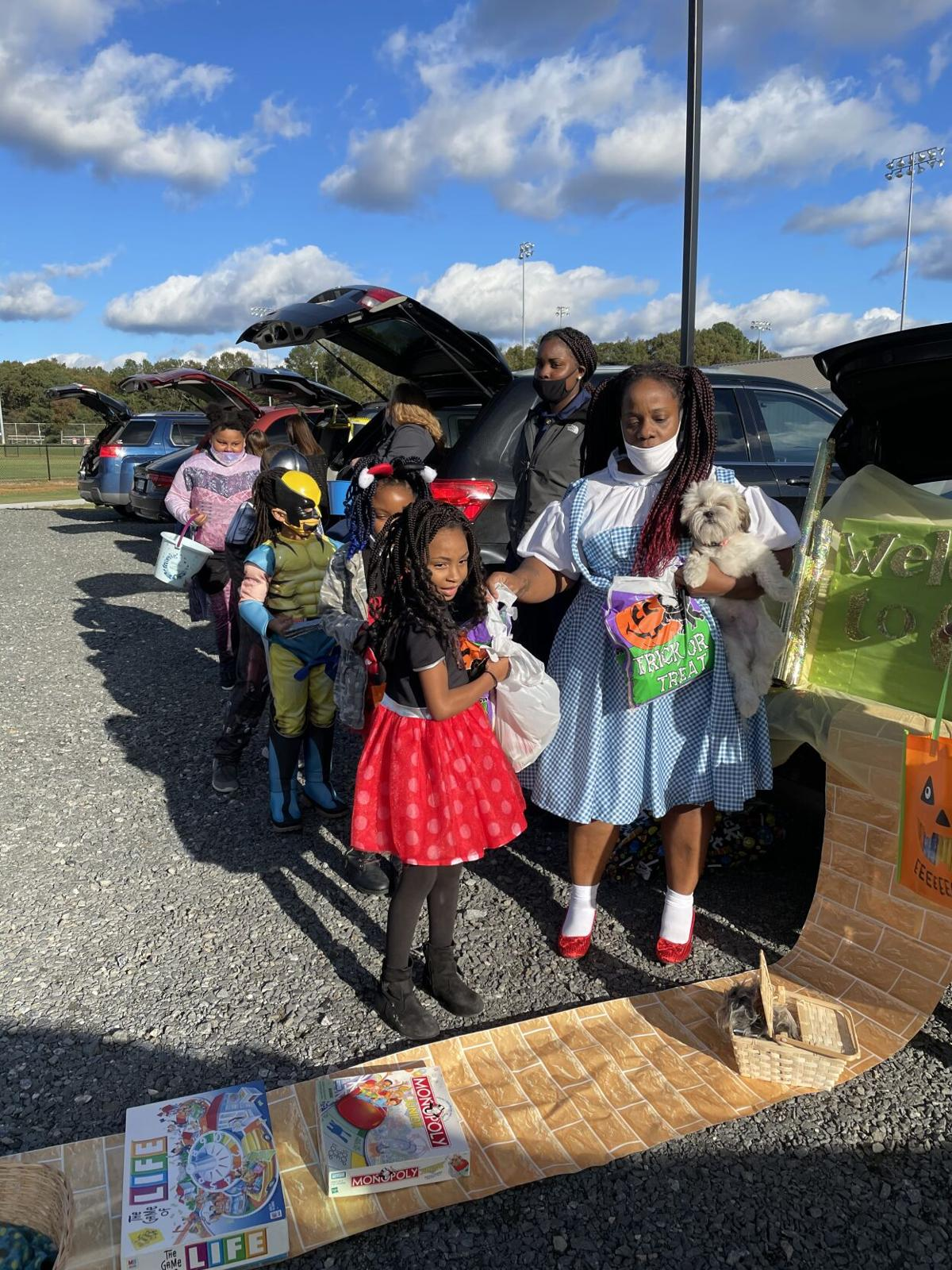 Timika leads kids to trunk of treats