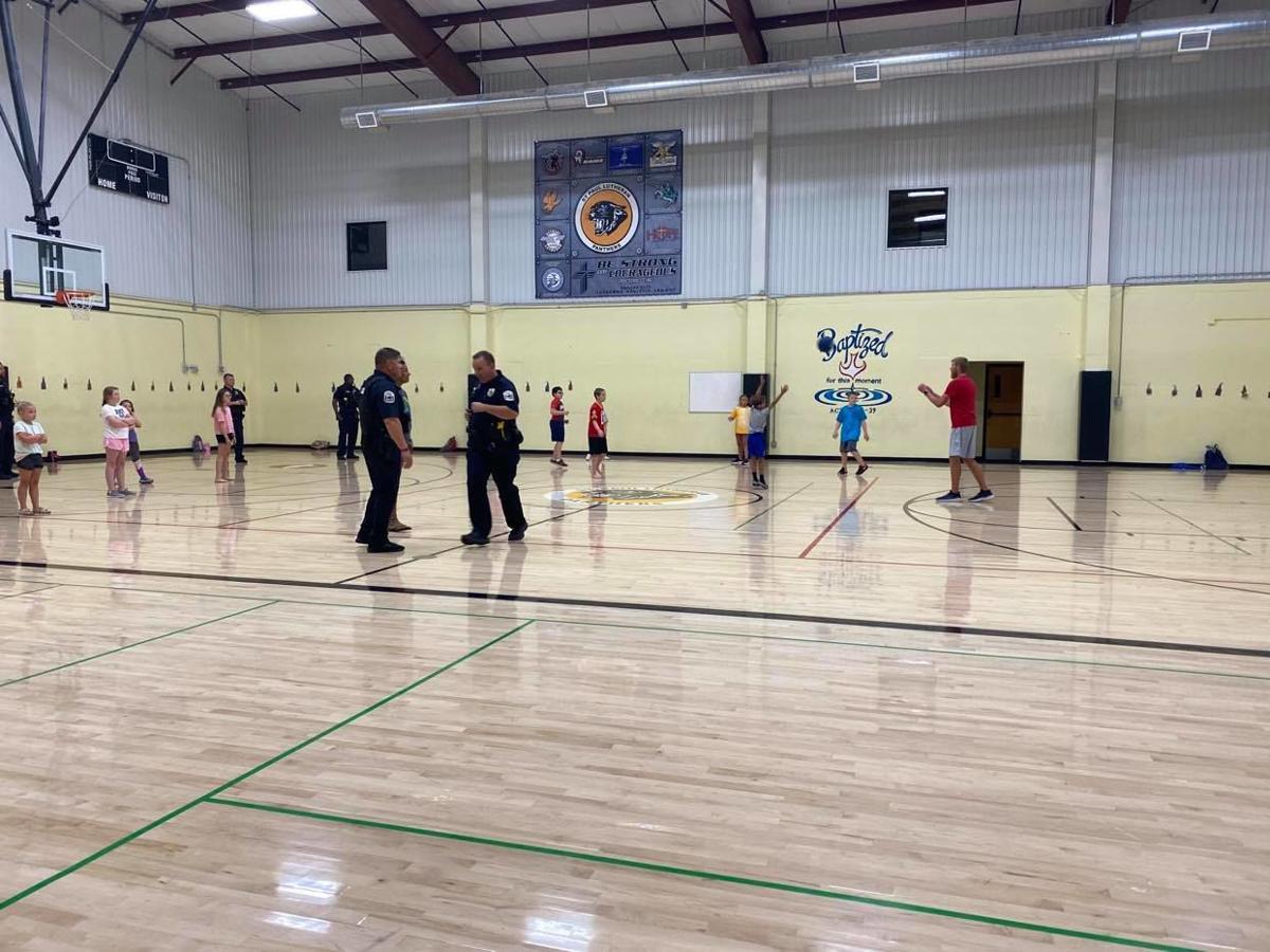 Officers playing kickball